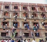 Vaishali: Youths climbing the building of an examination centre to help the candidates in cheating, by passing notes through the windows, during a Matriculation examination in Hajipur, on Wednesday. PTI Photo (PTI3_19_2015_000204B)